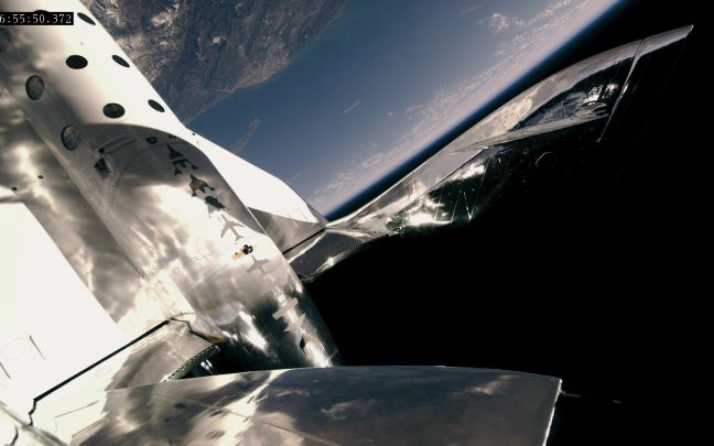 Virgin Galactic's SpaceShipTwo flying above Earth
