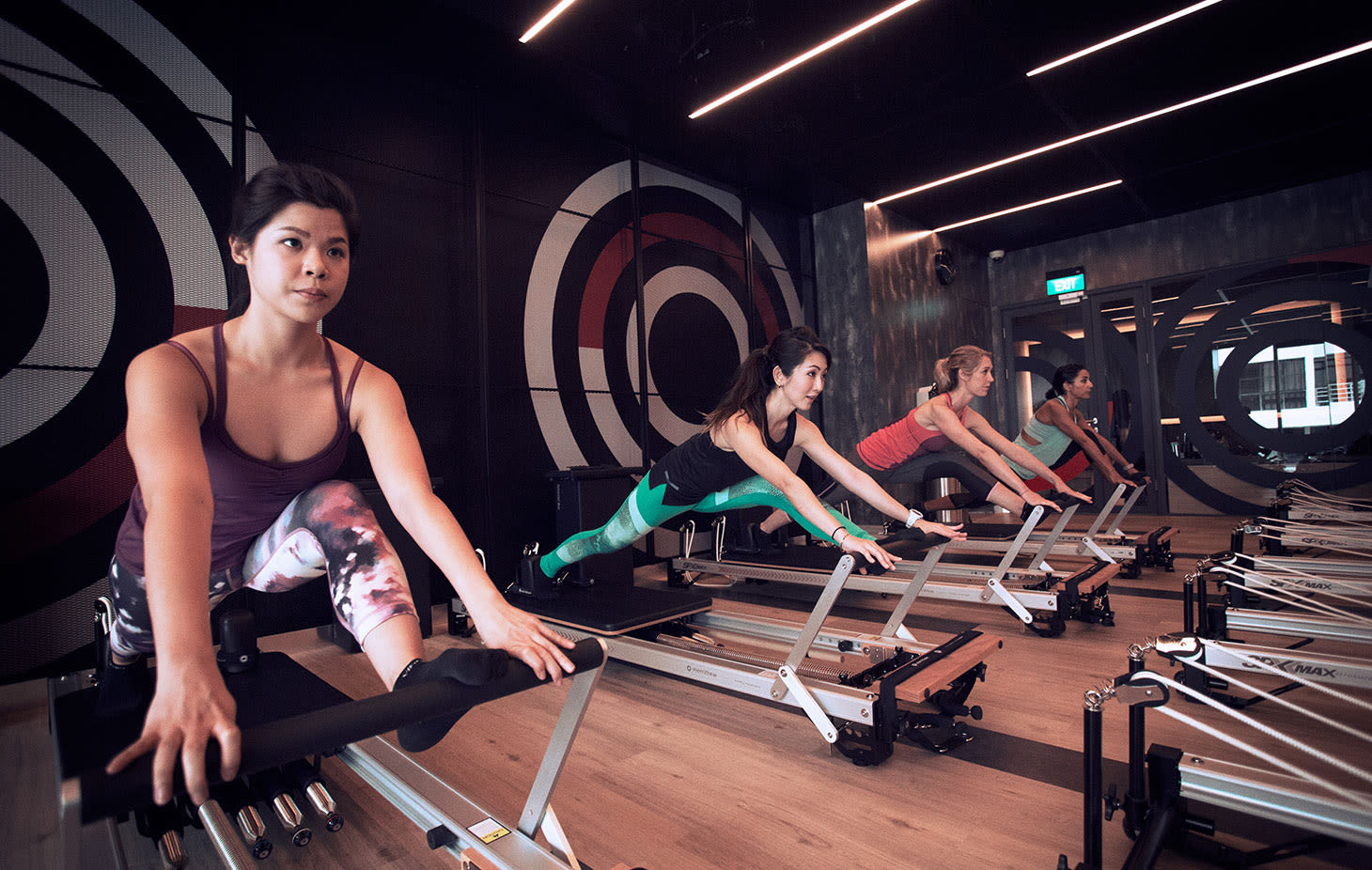 Women practising reformer pilates at a Virgin Active Singapore club
