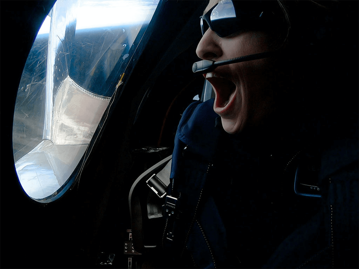Virgin Galactic's Chief Astronaut Instructor Beth Moses looks amazed as she looks out of the spaceship window during Virgin Galactic's second spaceflight