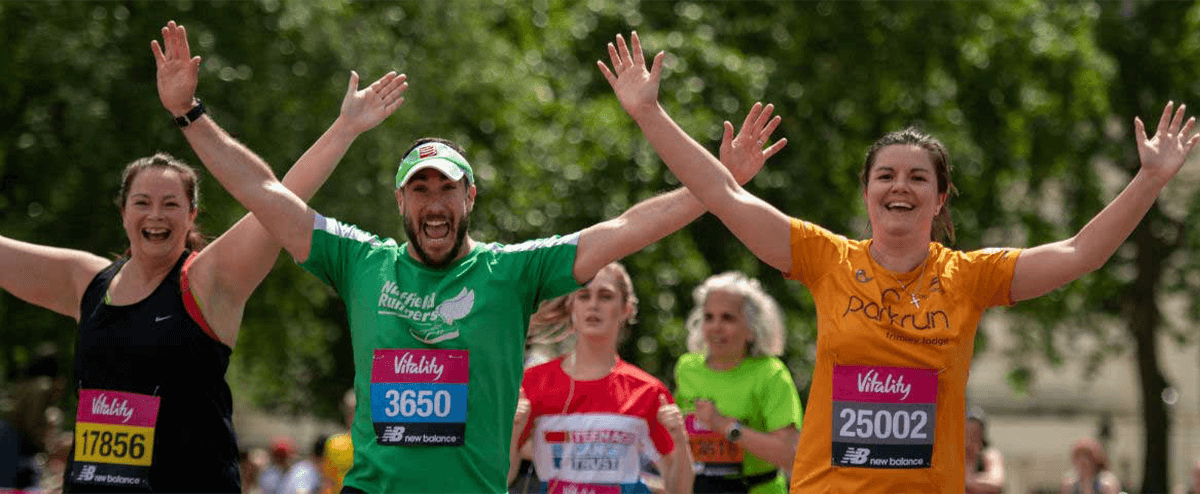 Three people celebrate while running