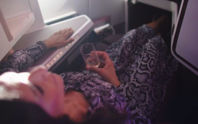 A woman reclining on a Virgin Atlantic plane