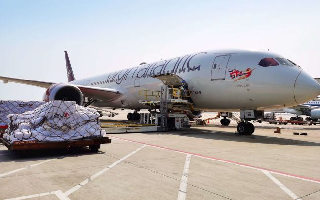 Medical supplies are loaded onto a Virgin Atlantic plane for a cargo flight