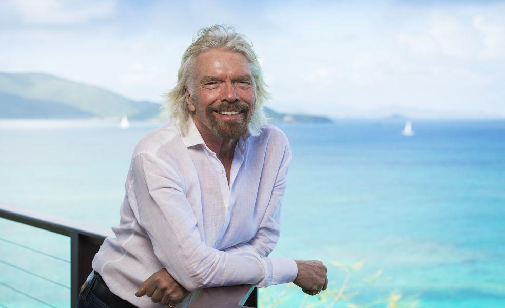 Richard Branson on Necker Island, with the ocean behind him