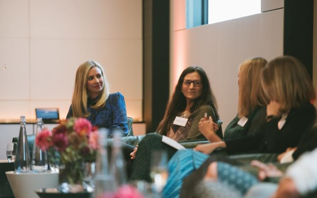 Holly Branson on panel listening to three other women