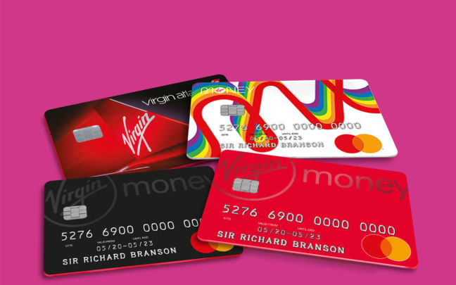 Four Virgin Money credit cards on a pink background