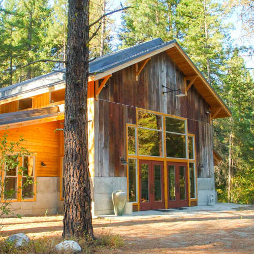 c s durham front facade of modern but rustic cabin home in the woods
