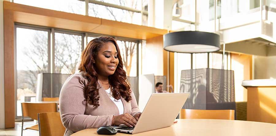 woman on laptop in atrium