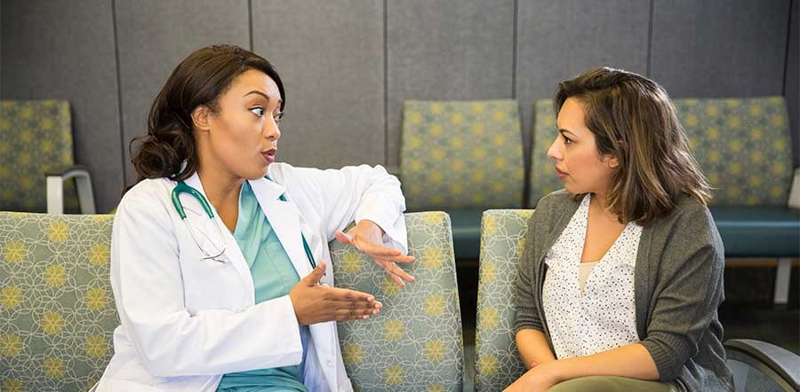 doctor talking to patient on bench