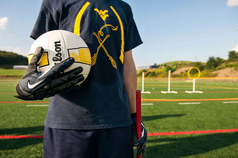 WVU Quidditch player in gold and blue team shirt