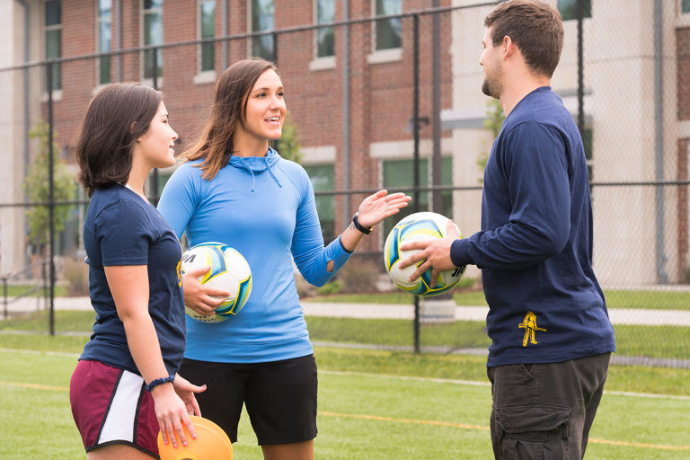 CPASS students converse on the recreation fields