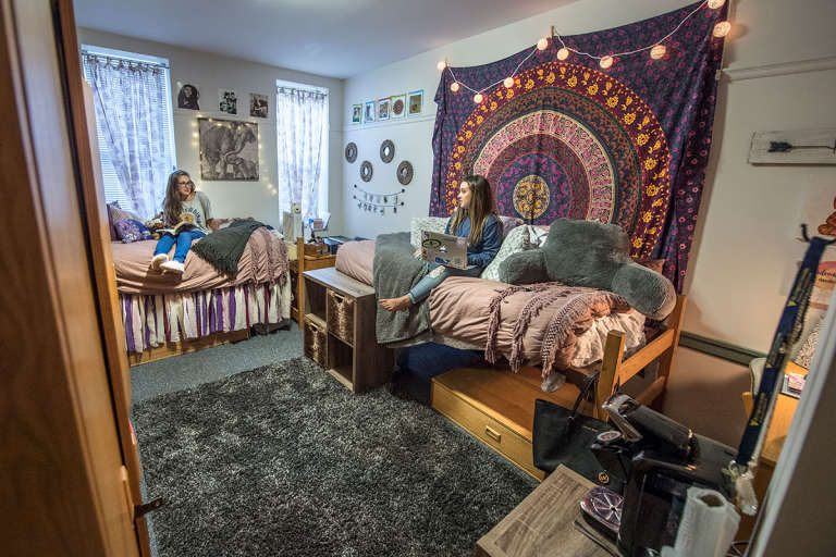 Two students relax in a dorm room