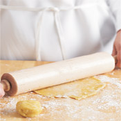 After mixing the pastry dough, divide it into two portions. Carefully roll each portion into a disk.