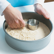 Pat the dough down with a measuring cup until evenly flat.