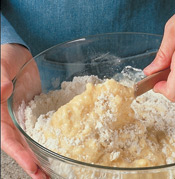 Gently fold wet ingredients into dry ingredients until just combined to avoid overmixing.