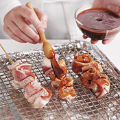 Coat the skewers with sauce on all sides before roasting, then turn and baste periodically for even cooking.