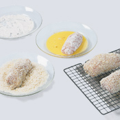 Coat chicken in flour, dip in egg, then coat with panko. Transfer coated chicken to a drying rack.