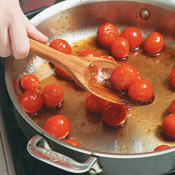 Briefly sauté the cherry tomatoes, then add the sugar and vinegar. Simmer until tomato skins split.