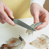 To devein shrimp, slice along the back to expose the vein; remove with the tip of a knife.