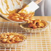 Pour the cashew-caramel mixture into the pastry shells. Let tarts cool before sprinkling with coarse salt.