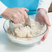 Cut cold butter into flour with a pastry blender until butter is broken down into pea-sized pieces.