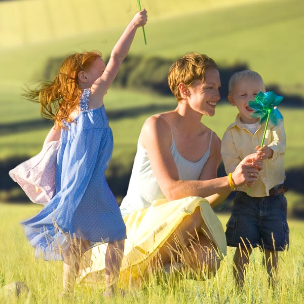 Woman is playing with children