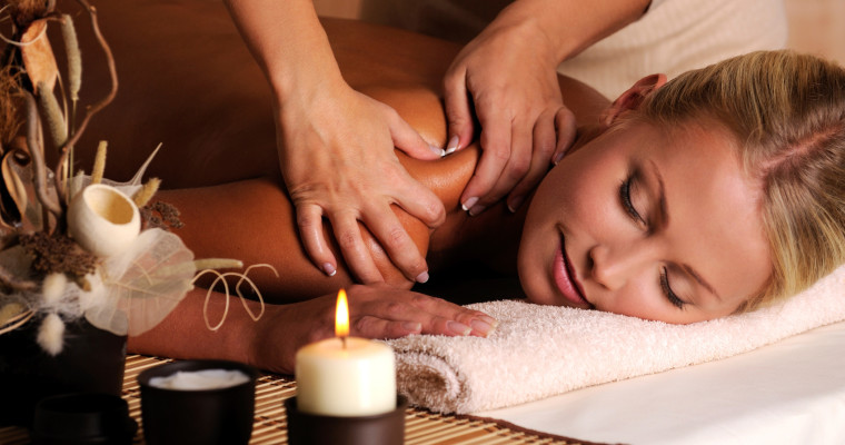 girl getting a massage at a spa IST