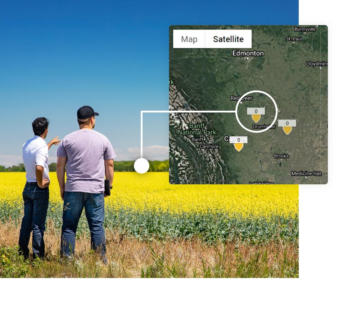 Men in farm field with satellite image
