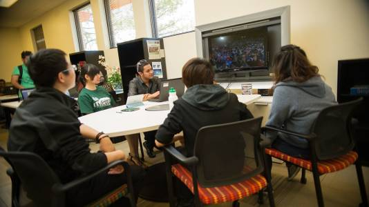 Students interact on Colorado State University video screen