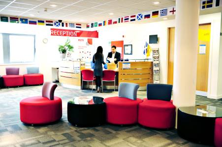 International student being helped by staff at INTO Centre reception desk