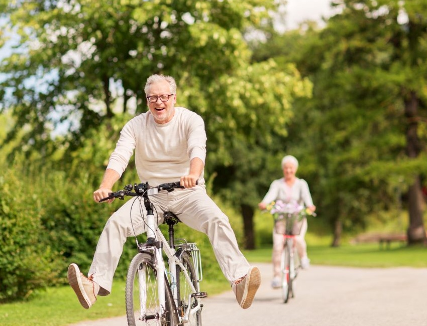 Old couple riding bikes together