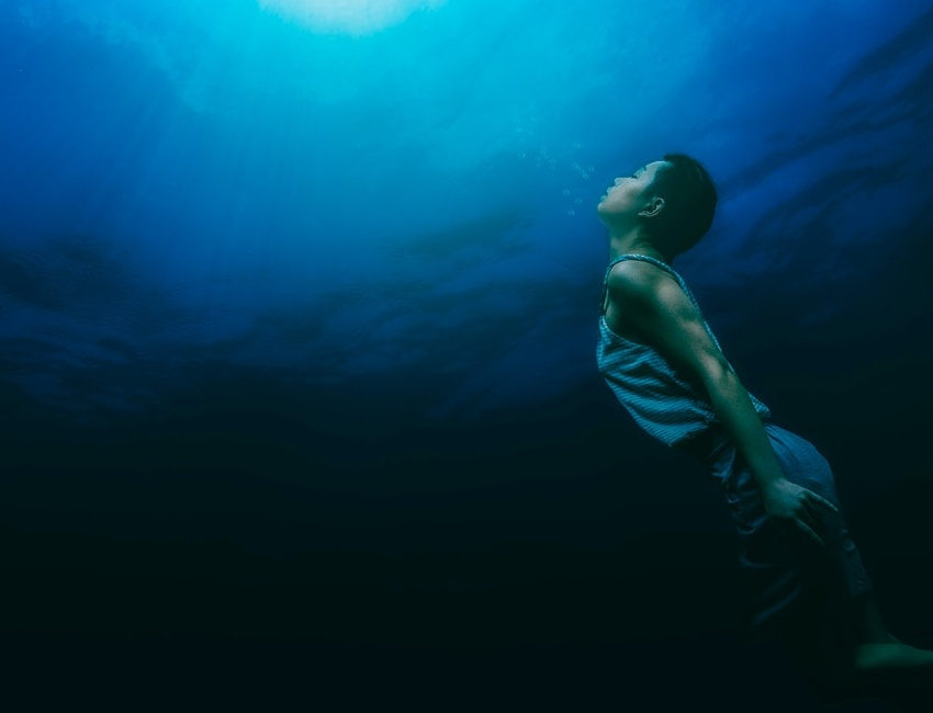 Person holding their breath underwater