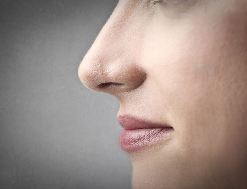 Woman breathing through her nose rather than mouth