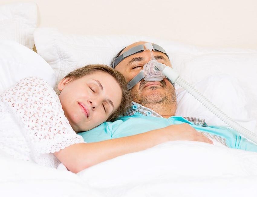 man suffering from sleep apnea or snoring