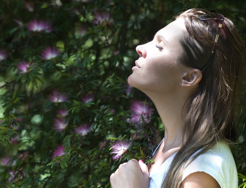 Woman breathing peacefully to reduce stress