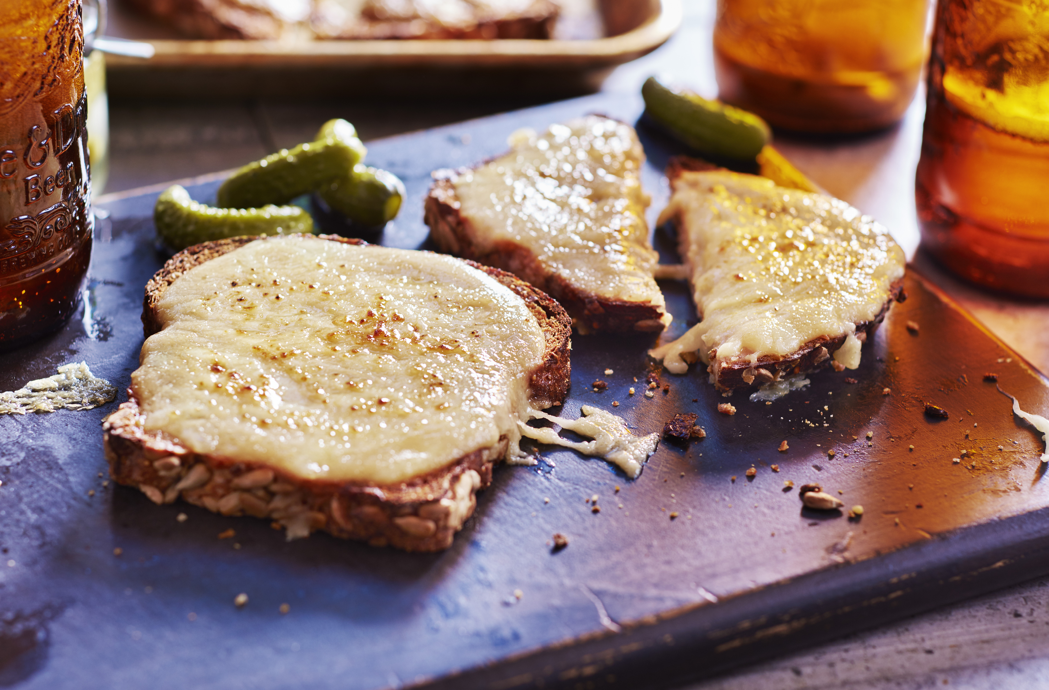 Slices of Welsh rarebit, comprised of toast covered in spiced cheese sauce