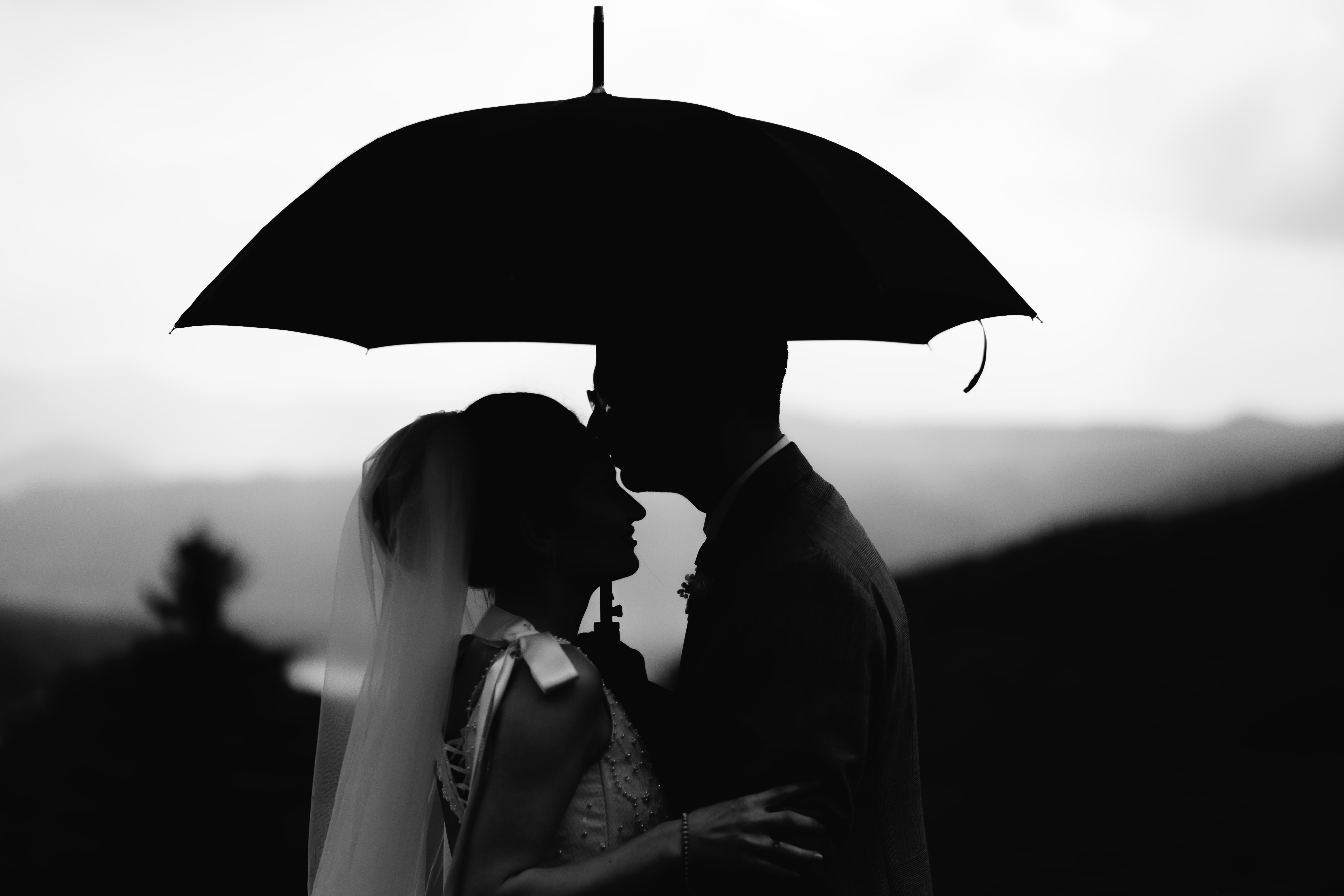 Be ready for bad weather on the wedding day. Image by Gabriel Crismariu