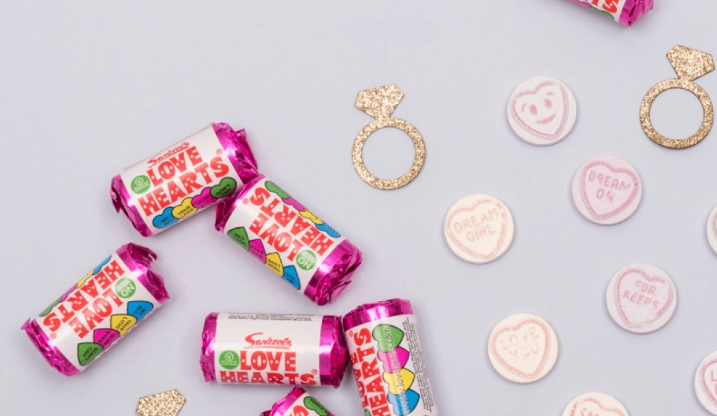 Love heart sweets and gold hen party decorations