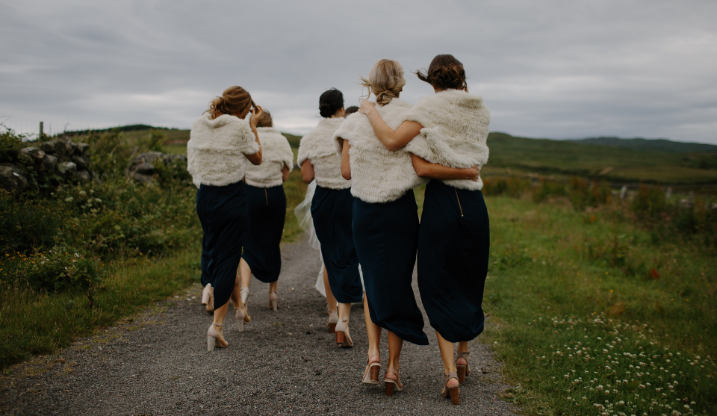 Women walking arm in arm