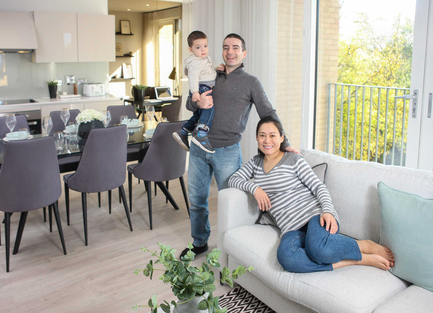 Image shows a young family at Barratt London's Hendon Waterside development