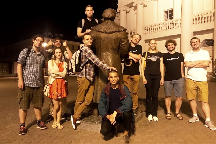 The YJ Minsk Team poses by a statue.