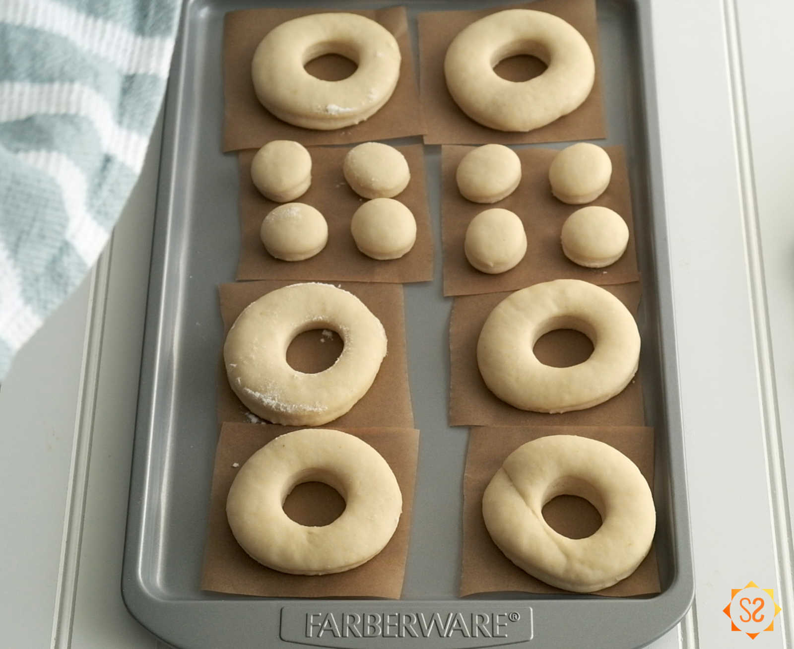 Donut dough on a baking tray after the dough has risen
