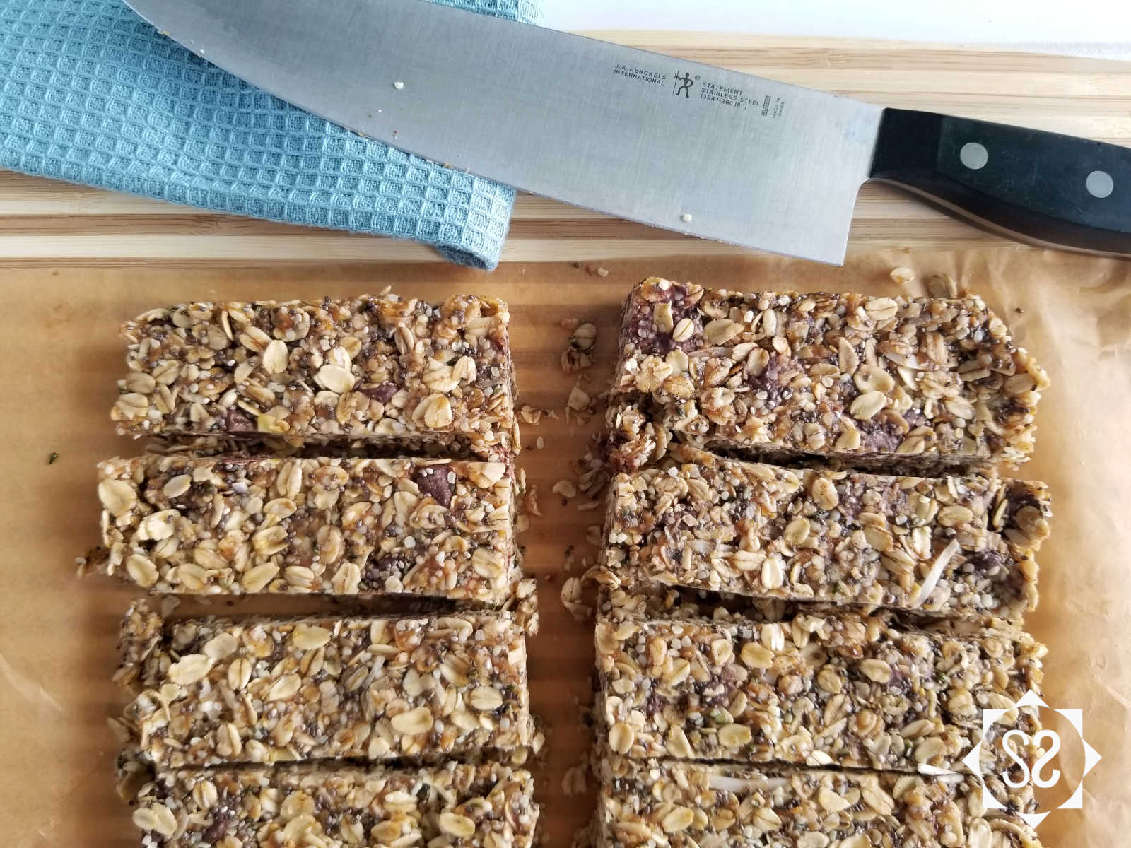 Granola bars cut up on a cutting board with a knife