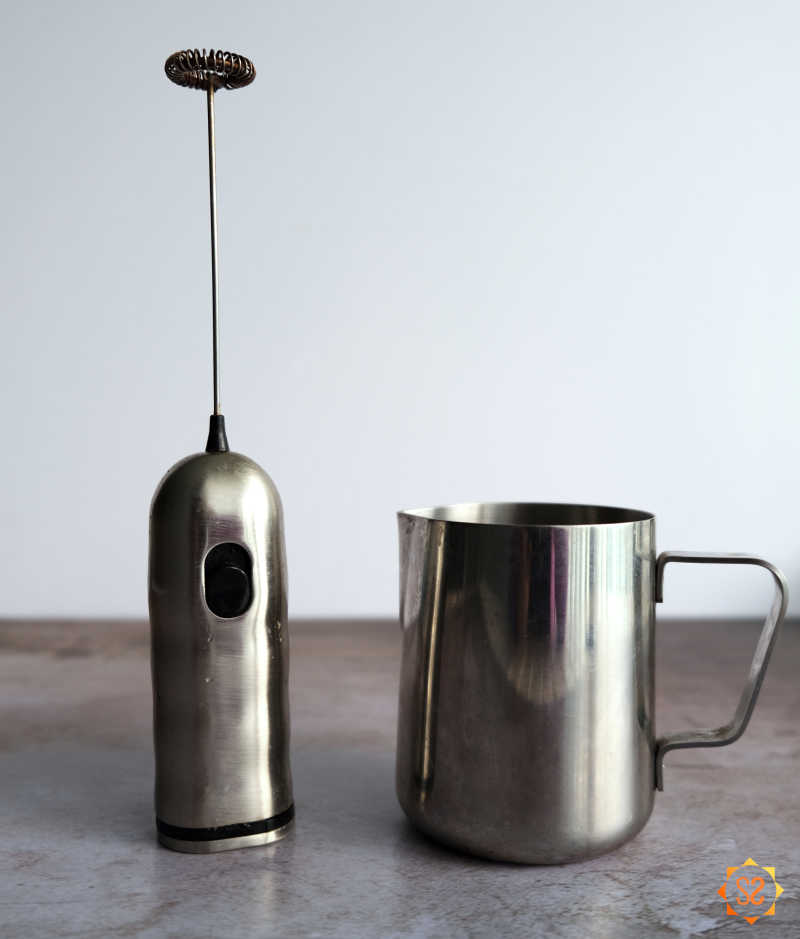 Milk frother and pitcher