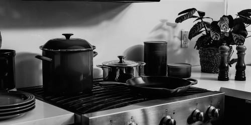 A moody, monochrome kitchen scene.