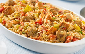 Chick and sausage jambalaya in a white casserole dish
