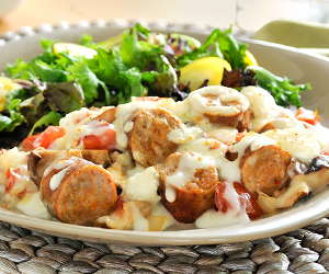 Italian sausage in cream sauce with a salad