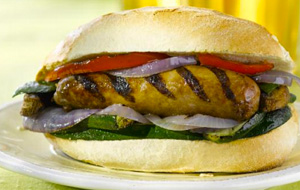 Sausage served in a bun with grilled veggies
