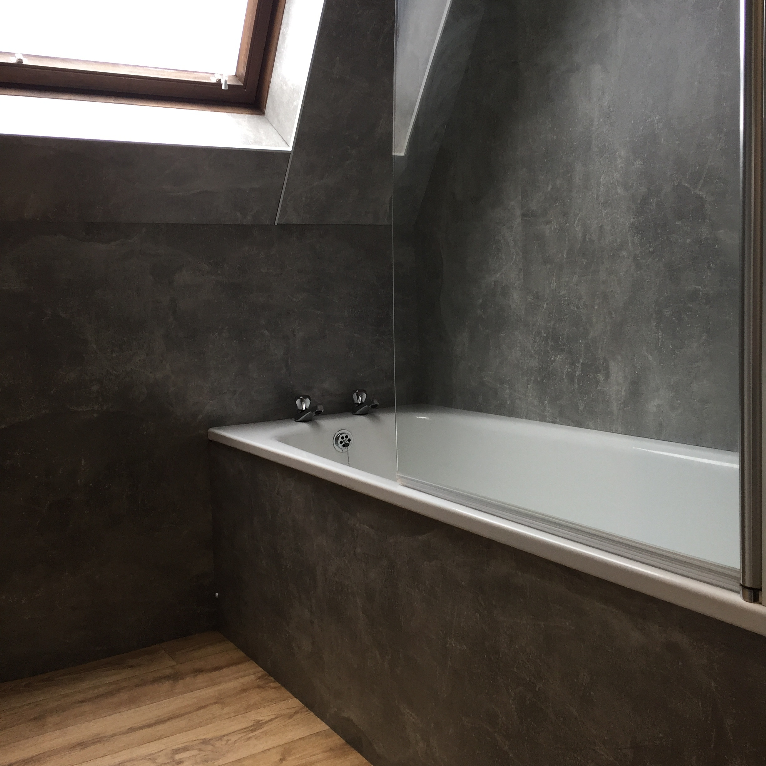 Bathroom with electric shower over bath