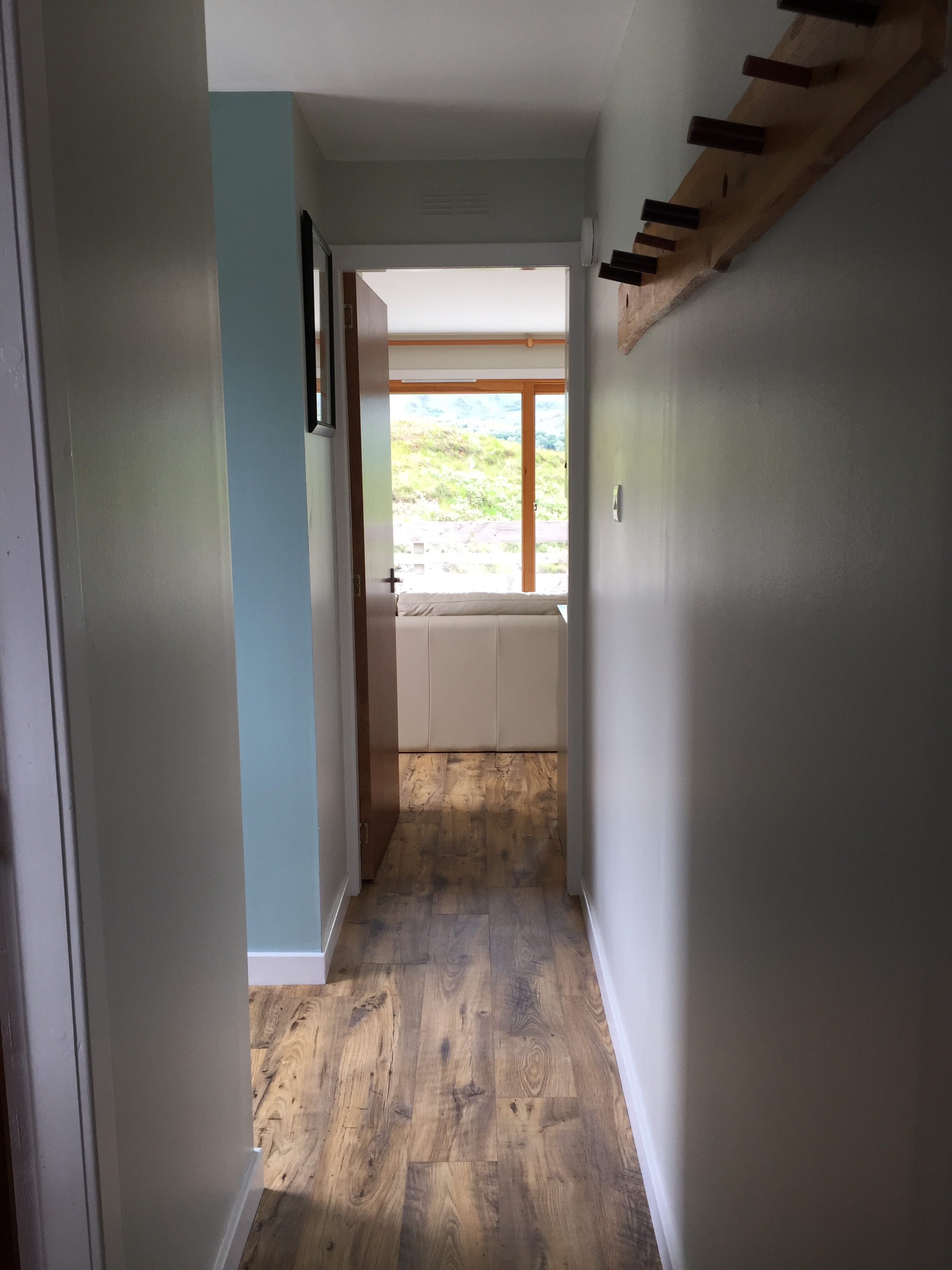 hall leading through to the open plan living space