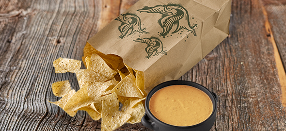 add a side of chips, salsa, queso, or guacamole to round out your meal!